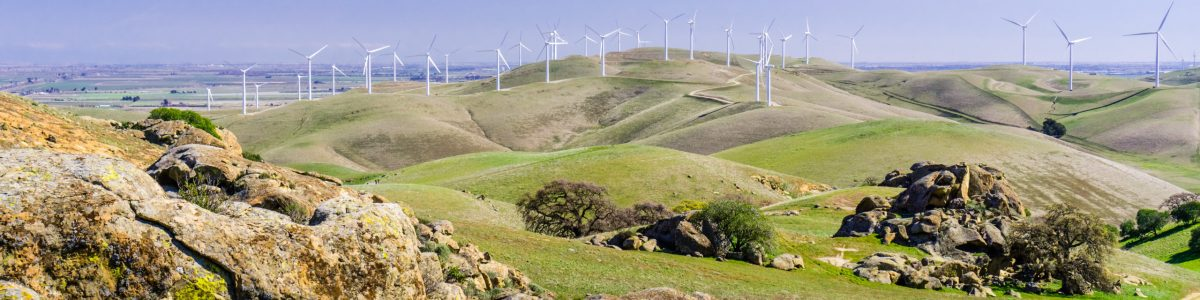 Rock formations on the hills of Costa Contra county; wind turbines in the background, east San Francisco bay area, California